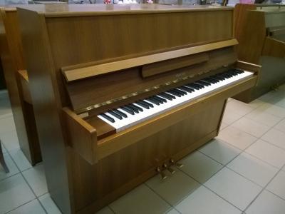 Petit piano d'occasion  HELLAS noyer foncé satiné